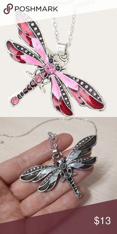 (R3) Pink Dragonfly Necklace Beautiful dragonfly necklace. Second pic is just an example of the size. This listing is for the pink dragonfly necklace only. New in package. Jewelry Necklaces