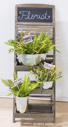 Here's an easy way to personalize floral arrangements or keep track of pretty potted kitchen herbs: balsawood plant stakes with in-full-bloom metal embellishments!