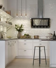 Combine traditional elements with modern décor to create a timeless kitchen design featuring sleek subway tiles, charming open shelving, and unique concrete countertops. Bonus: this inspiration is perfect for a small kitchen makeover! Bistro Kitchen, New Kitchen, Kitchen Dining, Kitchen Decor, Kitchen Tips, Beautiful Interior Design, Modern Interior Design, Interior Design Kitchen, Interior Design Living Room