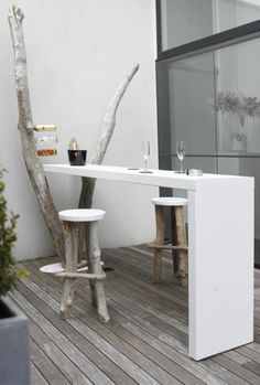 Le Bar. Collection Baptized by Nature. Designed by Catherine Op De Beek. Colours: white. Materials: driftwood, Corian®. Size 250x50x110 cm. Weight: (Kg) 100.  http://www.archiproducts.com/en/products/69443/baptized-by-nature-bar-rectangular-corian-table-le-bar-concepts-by-catherine.html