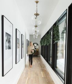 Those windows + balance with framed artwork #hallway