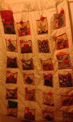 A self designed advent calendar using squares of Christmas material