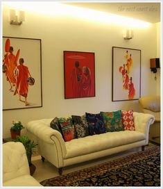 India Circus cushion covers, patterned rugs and paintings of monks