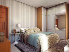 O papel ajuda a aproveitar espaço no quarto pequeno, decorado por Juliana Perret. Em lugar da cabeceira, o revestimento e um arranjo de almofadas para apoiar as costas.