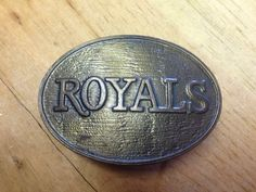 A personal favorite from my Etsy shop https://www.etsy.com/listing/243983946/royals-baseball-belt-buckle