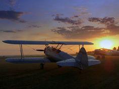 Bi plane at sunset by Curt l H, via Flickr