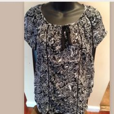 Black & white floral print top This is a brand new sheer blouse but it does not have a brand label . it also doesnt have fabric content or wash care instruction label. Only has a size label. Feel free to ask any further questions. Tops