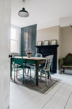 Vintage Distressed Table And Antique Chairs - Light Dining Room In A Period Property With Vintage Furniture.