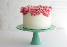 Project and Photos by Erica O'Brien  	   	  	   	Piped flowers are perfect for everything from backyard weddings to bridal showers to formal affairs. Although they had fallen out of favor during the height of the fondant craze, piping has made a huge comeback. You can use any buttercream recipe you like, but we prefer Swiss meringue buttercream. Because it's made with real butter, it has a slightly yellow tint, so be sure to practice on a small batch before adding...