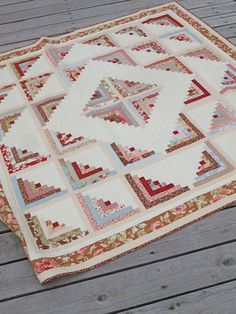 Log Cabin - Sparkling Diamond version by Fig Tree quilts, made from a honey bun and a charm pack plus background, border, etc.