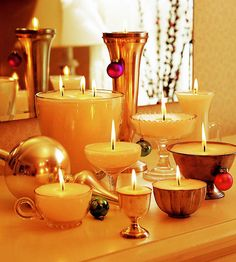 Small containers used as candleholders make striking mantel arrangements or centerpieces when grouped together for a romantic evening.