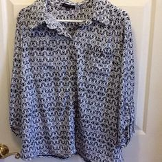 Black & White Blouse Gently worn black and white designed blouse. Has 2 breast pockets with silver buttons, and same silver buttons down the middle. Fabric is 95% polyester and 5% spandex. No stains or tears. No trades. Notations Tops Blouses
