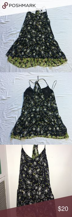 Floral Pattern Flowy Summer Dress Several layer floral pattern dress. Very flowy and never worn. Adjustable straps in the back to create either a longer or shorter length. Vera Wang Dresses Mini