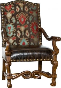 Built on an elegantly carved hardwood frame with supple leather, colorful fabric upholstery and antique nailhead accents. Measures 43.5H x 29W x 30D. Made in the U.S. Allow 8 weeks for delivery.