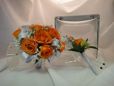 Orange Spray Roses make this wrist corsage and boutonniere! Silver accents tie them both together for Prom.  expressions24-7.com