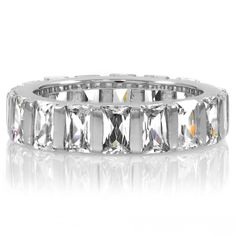 This sterling silver eternity band features brilliantly clear, Emerald Cut diamond CZ stones which run along the entire ring. Jewelry Shop, Jewelry Stores, Fine Jewelry, Commitment Rings, Cubic Zirconia Rings, Emerald Cut Diamonds, Eternity Bands, Diamond Engagement Rings, Silver Rings
