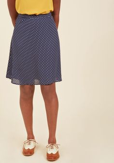 <p>You're putting every effort toward that promotion, including dressing the part in this navy blue skirt! Its satiny lining is topped with a white polka-dotted, chiffon overlay, offering a sweet sway as the cherry on top of your unstoppable drive.</p>