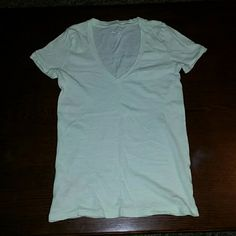 J. Crew Vintage Cotton V-neck Tshirt Light mint green colored t shirt in great condition! The color is best seen in the second pictured by the white paper, the first picture doesn't get the tint to show well.  Smoke free home J. Crew Tops Tees - Short Sleeve