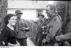 German soldier with woman . Russia . Operation Barbarossa. June 1941