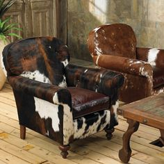 Cow hide covered chairs. more western decor than mountain lodge, but somehowmappealing.    KC Cattle Exchange Chair