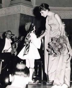Maria Callas with a young fan after a recital