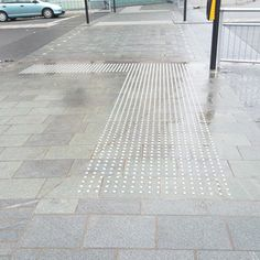 Tactile Paving is a system of textured ground surface indicators found on many footpaths, stairs and train stations platforms to assist blind and vision impaired pedestrians. http://tactilepaving.co.uk/tactile/