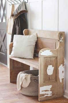 See how an old wood door transforms into a gorgeous, rustic bench! Get the full tutorial on LoveGrowsWild.com #WoodBenchDIY