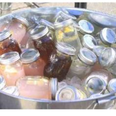 Mason jars filled with iced tea and lemonade in an ice-filled galvanized tub- perfect for summer cookouts!  #FeelGoodGrilling