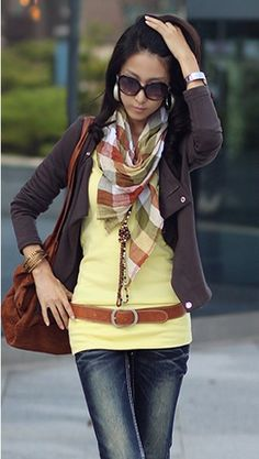 Layering scarf, cardigan, belt, and necklace.