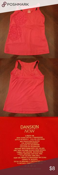 Danskin Now fitness tank. Large Danskin Now tank with built in shelf bra. Great for yoga. Large. Orange with very cute racer back design. Semi fitted. Notice pic where I cut the elastic in the shelf bra. Just trying to give the girls a little more room. LOL.dansdans Danskin Now Tops Tank Tops