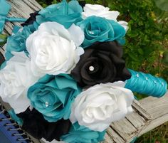 Sale - This listing is made to order and Includes 1 10in Round Rose Bouquet with Silk Malibu Blue(Turquoise) Roses, White Roses, Black Roses wrapped in Malibu Blue (turquoise) Satin Ribbon criss cross