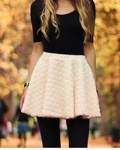 Plain black top with black leggings & a textured skirt :)