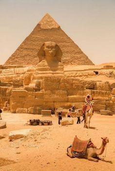 Sphinx & Pyramid In Cairo, Egypt Desert