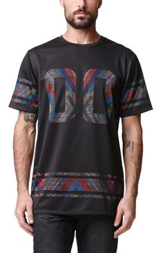PacSun presents the On The Byas Black Magic Mesh Jersey for men. This colorful men's jersey comes with numbers on the black mesh body and floral print.	Multi color football jersey	On The Byas patch sewn on bottom	Crew neck	Short sleeves	Regular fit	Machine washable	100% polyester	Imported