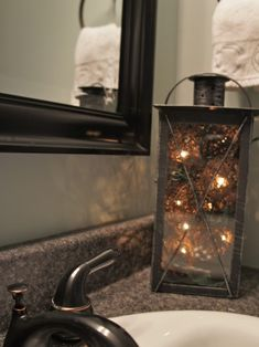 Lights and balls in bathroom lantern