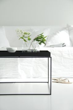 White living room with a black Tray table from Hay via Elisbeth Heier.