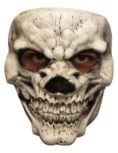 Masque Squelette sourire des enfers - adulte  : Ce masque en latex est peint à la main.Avec ses reliefs et ses zones d'ombres noires, le masque reprend les traits d'un squelette terrifiant! Son sourire maléfique...