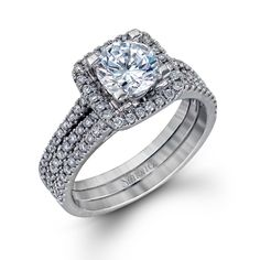 Jacket Collection - This gorgeous 18K white engagement ring and band is comprised of .50ctw round white Diamonds. - TR128