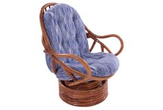 I have this exact chair (different cushions).  I picked mine up on the side of the road.  Rattan Swivel Chair | Spring Steals | One Kings Lane  $475.00