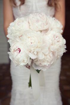 I like this bridal bouquet with hints of pink and some greenery throughout the bouquet too but not too much