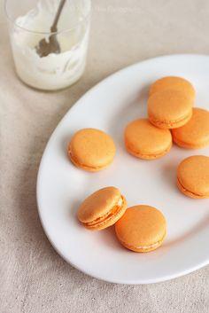 Cheerfully hued little mango mascarpone macaroons.