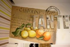 Decoration on the wall with acrylic andbrushes travel postcard reproduction for a men's clothing store #atelierovunque #ovunque #decoration #wall #interior #design #postcard #catania #handmade #acrilyc #orange #lemon #fruit #citrus #stilllife