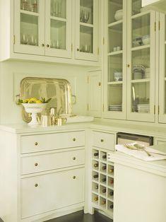 Tim Barber - Stunning kitchen with white glass-front kitchen cabinets, marble ...