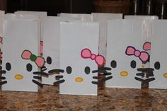 White shiny gift bags, pink bows outlined with different colors, 3 lengths black whisters & 2-shade yellow nose dots.  Bam!