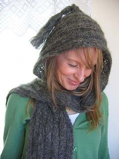 Scarf is worked in an interesting knit & purl combination that offsets every few rows for interest. Length is folded in half and a slip-stitch crocheted back seam forms the hood, which is finished off with a soft tassel. Cozy!