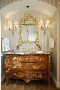 An example of French antique marble bombe commode (chest) repurposed as powder room bath vanity sink. There are endless possibilities: depending on finding the ideal size & style can be formal or casual depending on furniture selection.