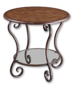 Uttermost Felicienne Accent Table 25 Inches Roundy by 24 Inches Tall by Uttermost. $217.80. Finish: Chestnut Brown. Material: MDF/Poplar Burl/Metal. Warm, chestnut brown burl veneer with a distressed, hand forged metal base in deep wood tones and a clear glass shelf.. Save 27%!