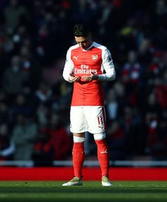 Mesut Özil prays prior to the kick-off during the Premier League match between Arsenal and Burnley at the Emirates Stadium on January 22, 2017 in London, England.
