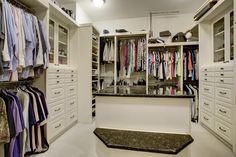 """WALK-IN MASTER CLOSET - 12' 2"""" x 13' 4"""" Custom configured w/organizational  components; center packing island: granite counter and two sides with 6  drawers; ..."""