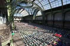 Participants at a large yoga gathering hosted by a group of volunteer teachers in support of 'Mecenat Chirurgie cardiaque', a cardiac surgery association which saves children's lives through funds raised at the Grand Palais in Paris, France, on October 9, 2016.